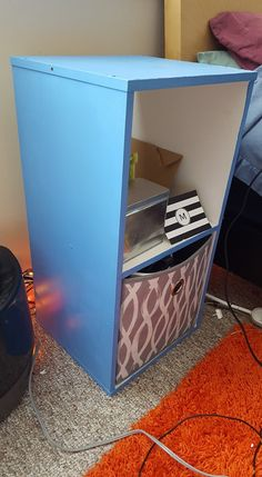 Blue painted target bookshelf/night stand. Flexible pattern box from Target.