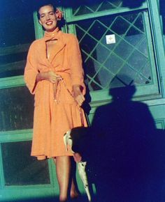 Edie and Spot II, the summer she was badgered by Big Edie to return home to Grey Gardens, 1952. Big Edie took this photo, she loved to cast a shadow!