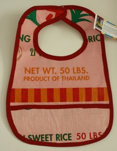 Love theses bibs made from recycled rice bags.  Made by Burmese refugees.  Only $10 each.  What a great baby shower gift.  So cute.