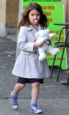 Suri Cruise's Cutest Outfits - Seriously, a pacifier?  How old is this kid?  OMG, and they wonder how Hollywoods kids get so screwed up!