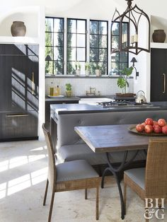 While island seating is a popular kitchen amenity this island includes a furniture-look banquette for extra seating at a wooden table. The banquette's middle-of-the-room location leaves clear routes to adjacent areas. Kitchen Island And Table Combo, Kitchen Island With Seating, Kitchen Corner, New Kitchen, Kitchen Island With Table Attached, Island Kitchen, Island Bench, Corner Table, Kitchen Small