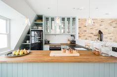 Transitional Kitchen by Domus Nova