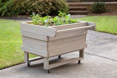 With casters and a built-in handle, this portable planter can be moved anywhere you have sun and a bit of extra space. It can even be wheeled into the greenhouse or garage when needed. Learn how to build it with Bonnie Plants. Farm Gardens, Outdoor Gardens, Container Gardening, Gardening Tips, Planter Boxes, Planters, Fenced Vegetable Garden, Herb Garden, Garden Art
