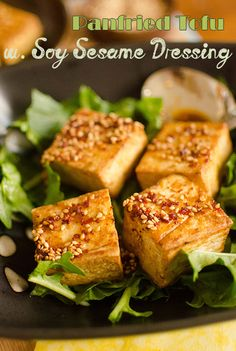Serves: 2  Ingredients ◦½ tofu, cut into 1½ inch squares ◦cooking spray or oil ◦2 tablespoons soy sauce ◦1 teaspoon sesame oil ◦1 teaspoon Korean pepper flakes (gochugaru) ◦1 tablespoon sesame seeds ◦green onions, chopped (optional)