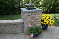 landscaping lights for stone walls | Manufactured stone collums w/ seat wall and light