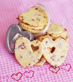 Cranberry Cornmeal Cookies - so pretty...rich buttery cornmeal & red of fruit; <3 d ingredients of these: 1 cup sugar  1 tablespoon grated orange zest  4 large egg yolks 1 cup yellow cornmeal  2 1/2 cups all-purpose flour  1/2 tsp salt  3/4 cup dried cranberries