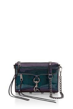Iridescent Mini M.A.C. Crossbody - A petite take on your favorite M.A.C. (Morning After Clutch) that's a little too cute for words!  With just enough space to stash your must-haves (lipgloss, cell phone, wallet, keys, and sunglasses) this compact style goes from daytime fun to evening with flair. Adjustable chain and studded leather strap can be singled, doubled, or removed.
