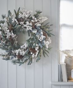 If you're having guests over then this design is full of mistletoe! It embodies everything that's joyful about Christmas – white frosting mimicking snow, fir tree sprigs and real pine cones in a relaxed style. Christmas Wreath Image, Christmas Reef, Christmas Wreaths For Front Door, Holiday Wreaths, Christmas Home, Christmas Decorations, Holiday Decor, Winter Wreaths, Spring Wreaths