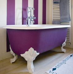 Clawfoot tub painted purple and white to match the broad wall stripes -- LOVE IT!   tumblr.com