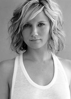 Short wavy bob hairstyle with side swept bangs