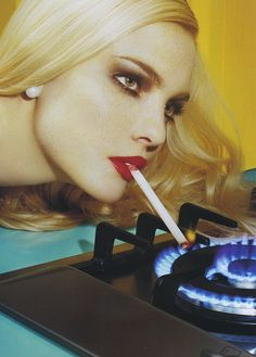 Light 'em up. 1960s (but how many times did I light a ciggy with the gas flames in the 70s, 80s & 90s?)
