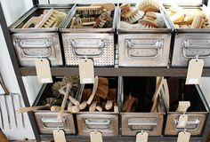 I like this industrial look, but most of all I love the idea of organized storage!