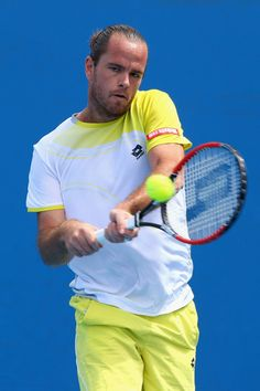 Xavier Malisse of Belgium plays a backhand in his first round match against Pablo Andujar of Spain during day one of the 2013 Australian Open at Melbourne Park on January 14, 2013 in Melbourne, Australia.