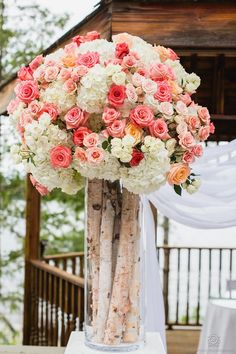 Tall wedding centrepiece - Peach and coral flowers - Rowell Photography | Floral: Rachel A. Clingen