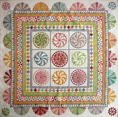 """""""Happy Daze"""" quilt and pattern by Sue Garman: swirly pinwheels, straight pinwheels, sawtooth and half-Dresden-plate borders"""