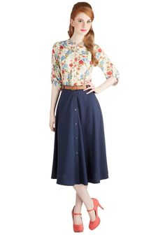 Pretty floral blouse with lovely belted long buttoned skirt.