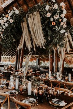 Pampas grass + coral and blush roses created a romantic yet boho feel at this beach wedding reception | Image by Brooke Taelor