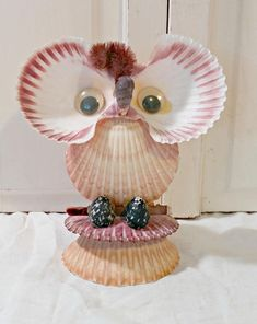 Vintage shell owl measures 6 tall x 5 1/2 wide. This little owl is so adorable... made entirely of shells with big googly eyes and a chenille top knot, he will be adorable on any shelf or table! Take a look in the shop for more great eclectic home decor finds: