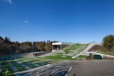 D.LIM architects digs subterranean forum for CJ nine bridges in korea - designboom | architecture & design magazine