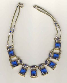Czech necklace of blue glass and enameled floral accents.