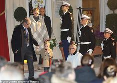 Prince Albert, meanwhile, was suitably dapper in a grey suit and black wool coat while lit... Prince Albert Of Monaco, Prince Hans, Charlene Of Monaco, Fitted Black Dress, Gucci Kids, Black Wool Coat, Patron Saints, Dapper, Suit