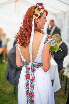 Folk wedding dress with flower wreath ....looks amazing! More from this wedding here: http://www.sashe.sk/moja-handmade-svadba2#dievcatko-oravsko