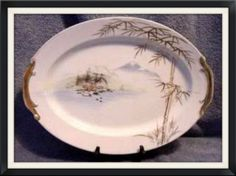 "Artware Oriental Platter Handpainted island Scene by lovevintagehouseware, $59.95 vintage china artware Japanese Pottery - Outstanding example of mid century hand painted porcelain. 14 1/4"" long, beautiful hand painted oriental island scene, Gold trim. Very good used condition with trim wear and a small chip in the center foot underneath (visible in the picture).I am fairly certain it is Japanese. I believe this to be a 1950's piece"