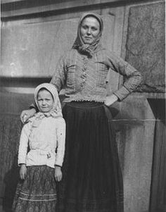 YMCA social welfare worker Ludmila Foxlee with an immigrant girl on Ellis Island c. 1920s. Foxlee is dressed in peasant garb.