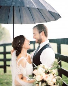Proof that wedding day downpours make for sweet photo ops...