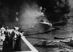 Crews leaving USS California sinking after being hit by two torpedoes and bombs 7th Dec41