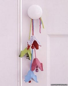 flower  or bell door bell jingles! Can be a fun christmas or even spring craft. Made from egg cartons, ribbon and bells.