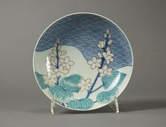 Dish with Design of Waves and Water Plants  Period: Edo period (1615–1868) Date: early 18th century Culture: Japan Medium: Porcelain with underglaze blue decoration and overglaze enamels (Hizen ware, Nabeshima type) Dimensions: H. 1 3/4 in. (4.4 cm); Diam. 5 7/8 in. (14.9 cm) Classification: Ceramic