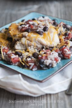 Southwest Black Bean Chicken & Rice - this is a fantastic, flavorful, simple little recipe using basic pantry ingredients.  HINTS:  You can make this dish EASIER by skipping the brown-the-chicken step.  You can make this dish FASTER by making it on the stove top.  Once you've browned the chicken, add in all the ingredients, bring to a boil, cover, turn as low as you can, and it'll be done in 30 min.  Fluff with fork to serve.
