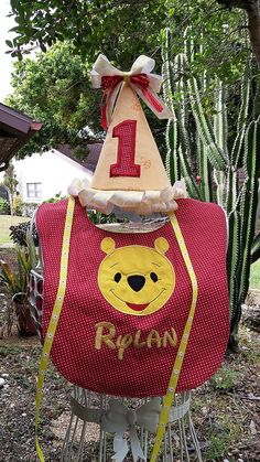 New custom Winnie the Pooh inspired 1st Birthday set, fabric birthday hat and bib.