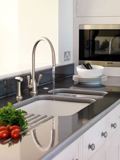 Gallery of projects with Pyrolave glazed Volvic lava stone kitchens benchtops.