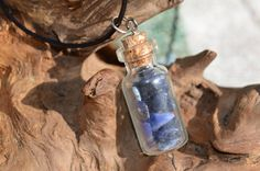 Genuine sodalite stone chips in a vial on a real leather cord necklace with lobster clasps. Glass vial necklace filled with sodalite healing