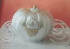 I'm not one for girly things.. at all... but this is adorable! Turn a squash or pumpkin into a Cinderella carriage. Paint with white primer then a white pearl paint. Dry. Paint stem and carriage door with gold metallic paint. Dry. Add stick on jewels or pearls for the door. And for wheels, coil silver and white chenille stems or pipe cleaners.