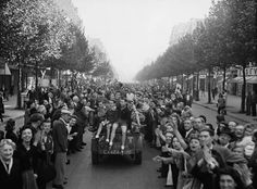 Crowds in Paris welcoming troops. 25 Aug. 1944. LAC MIKAN 3194296