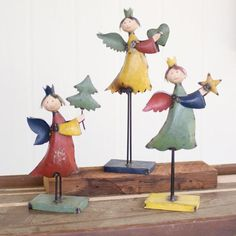 "Recycled Metal Angels On Metal Base-holding Heart, Tree And Star (Set of 3) Product Dimensions: largest 4"" x 6"" x 21""t one each holding heart, star, and treecol"
