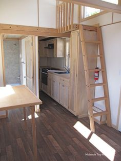 The Streamline: a fifth-wheel tiny house from Molecule Tiny Homes. Features two bedrooms, a workspace, and a full kitchen!