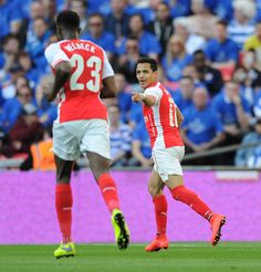 Alexis Sanchez celebrates scoring the 1st Arsenal goal during the FA Cup Semi Final between Reading and Arsenal at Wembley Stadium on April 18, 2015.