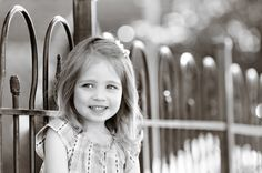 """Portrait of little girl on metal fence, Black and White photography - Giraffe Photography """"A Head Above the Rest""""  www.giraffephoto.com"""