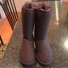 Ugg Boots Womens size 5, classic tall brown Ugg Boots. Never been worn!! UGG Shoes Winter & Rain Boots
