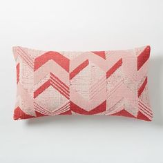 Broken Arrow Pillow Cover - Poppy, $39, West Elm. Joanna likes to do red and pink pillows on her sofas for February for her kids. They stand out more on her white sofas.
