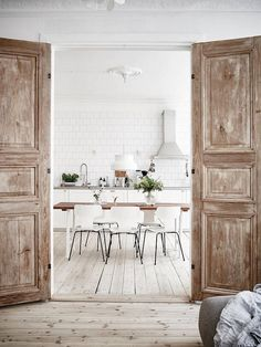 Minimalist Swedish kitchen with vintage French doors
