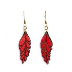 Rama Red Walnut Earrings: These elegant bright red earrings are based on an original hand drawn illustration by Marta Chojnacka. -Painted by hand at her Barcelona workshop -Made using natural solid walnut wood -A varnish coat has been applied by hand to each item for a lasting finish