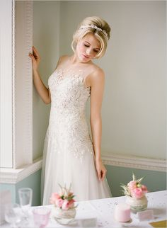 a little bit more fit on top and more flare on the bottom but it is elegant and beautiful with the soft hairstyle