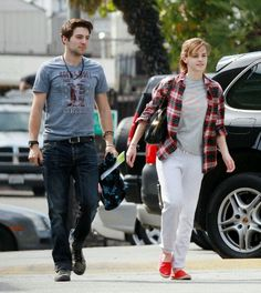 Emma in Los Angeles. (March 13) cute guy walking with her!