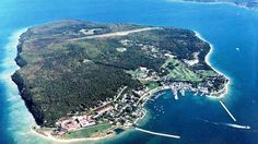 Mackinac Island looks really small when you're coming in for a landing at the airstrip! Michigan Vacations, Michigan Travel, Dream Vacations, Vacation Spots, Places To Travel, Places To See, Mackinaw City, Mackinac Bridge, Mackinac Island