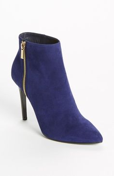 Lanvin Ankle Boot | Another ankle boot w/ a rock  roll spirit. Black leather pants and a sexy lavender top for a soft look or a screen T and leather jacket are the perfect addition to these funky purple suede booties. A must have for my closet.